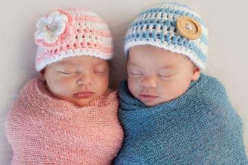 boy girl twins in knit hats