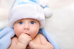confused boy with blue hat